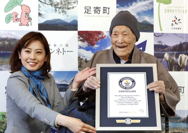 Japanese Masazo Nonaka, who was born 112 years and 259 days ago, receives a Guinness World Records certificate naming him the world's oldest man during a ceremony in Ashoro, on Japan's northern island of Hokkaido, in this photo taken by Kyodo April 10, 2018