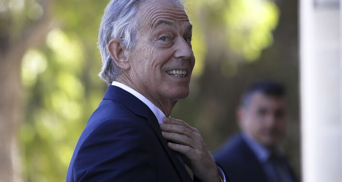 Former British Prime Minister Tony Blair arrives at the presidential palace for a meeting with Cyprus' President Nicos Anastasiades in capital Nicosia, Cyprus, Wednesday, April 4, 2018.