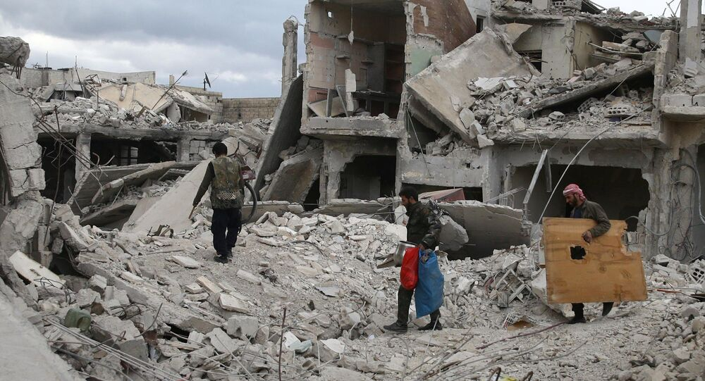 People walk on rubble of damaged buildings in the besieged town of Douma, Eastern Ghouta, in Damascus, Syria