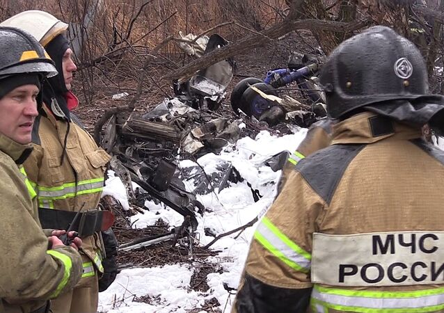 Emergencies Ministry rescuers at the crash site of a Mil Mi-8 helicopter that had a rough landing killing six people. A screenshot from a video provided by the Russian Emergencies Ministry