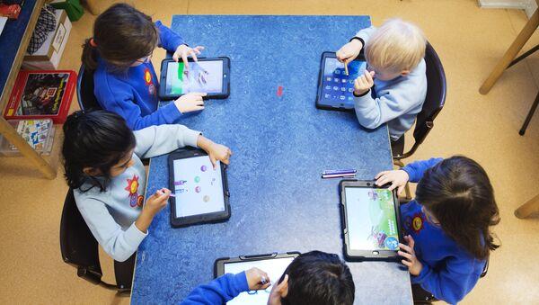 Nursery school pupils work with iPads (photo used for illustration purpose) - Sputnik International