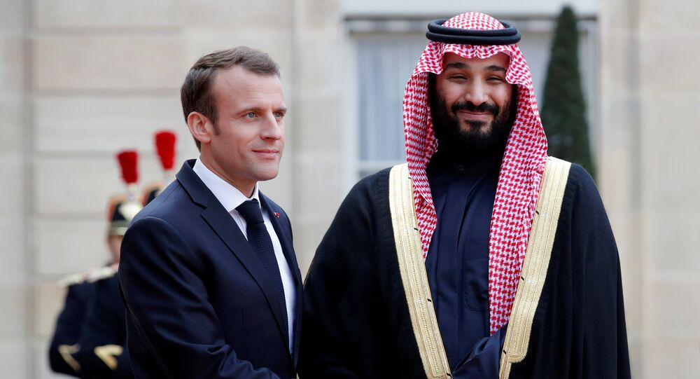 French President Emmanuel Macron welcomes Saudi Arabia's Crown Prince Mohammed bin Salman as he arrives at the Elysee Palace in Paris, France, April 10, 2018