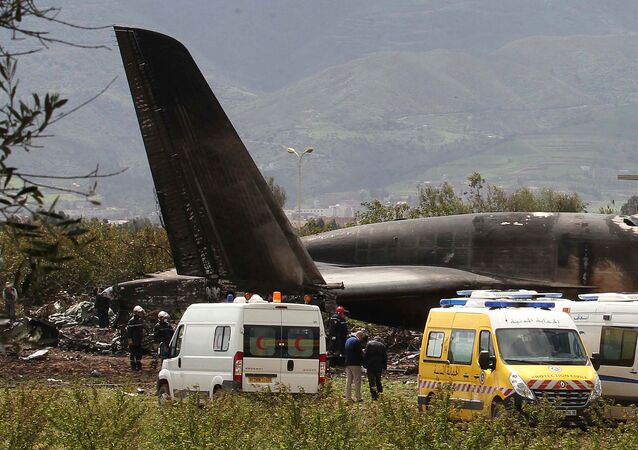 Firefighters and civil security officers work at the scene of a fatal military plane crash in Boufarik, near the Algerian capital, Algiers, Wednesday, April 11, 2018