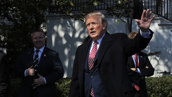 President Donald Trump waves as he leaves South Lawn following a ceremony to honor the 2017 NCAA football national champion, the Alabama Crimson Tide at the White House in Washington, Tuesday, April 10, 2018 - Sputnik International