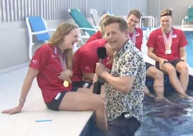 Mike Bushell falls into pool