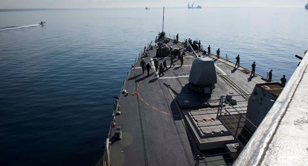 U.S. Navy sailors man the rails aboard the Arleigh Burke-class guided-missile destroyer USS Donald Cook as the ship departs Larnaca, Cyprus, April 9, 2018