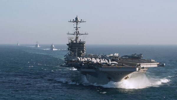 The aircraft carrier group of the United States Navy led by USS Harry S. Truman, front, and a ship escort are seen leaving the port of Norfolk heading for the Middle East. File photo - Sputnik International