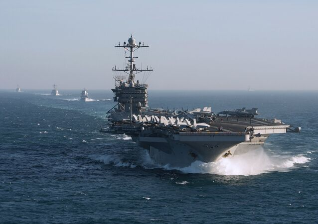 The aircraft carrier group of the United States Navy led by USS Harry S. Truman, front, and a ship escort are seen leaving the port of Norfolk heading for the Middle East