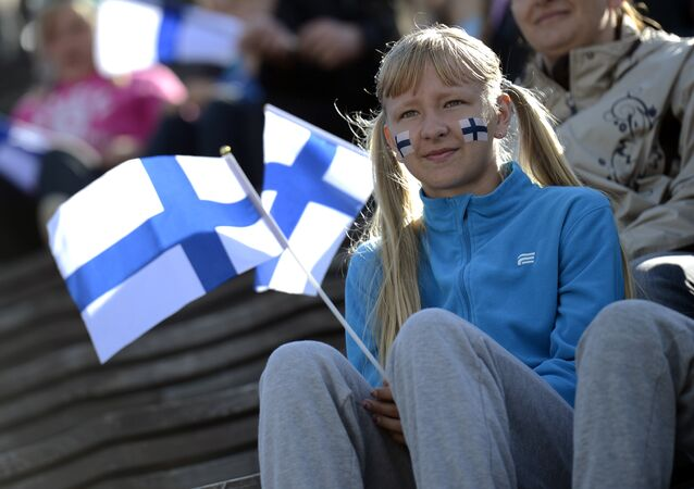 A girls holds a Finnish flag on the first day of the 2012 European Athletics Championships at the Olympic Stadium in Helsinki on June 27, 2012