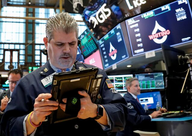 The Dow Jones Industrial average is displayed on a screen after the closing bell at the New York Stock Exchange, (NYSE) in New York, U.S., April 10, 2018
