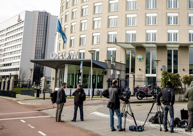 Journalists wait outside the headquarters of Organisation for the Prohibition of Chemical Weapons (OPCW) on April 4, 2018 in the Hague