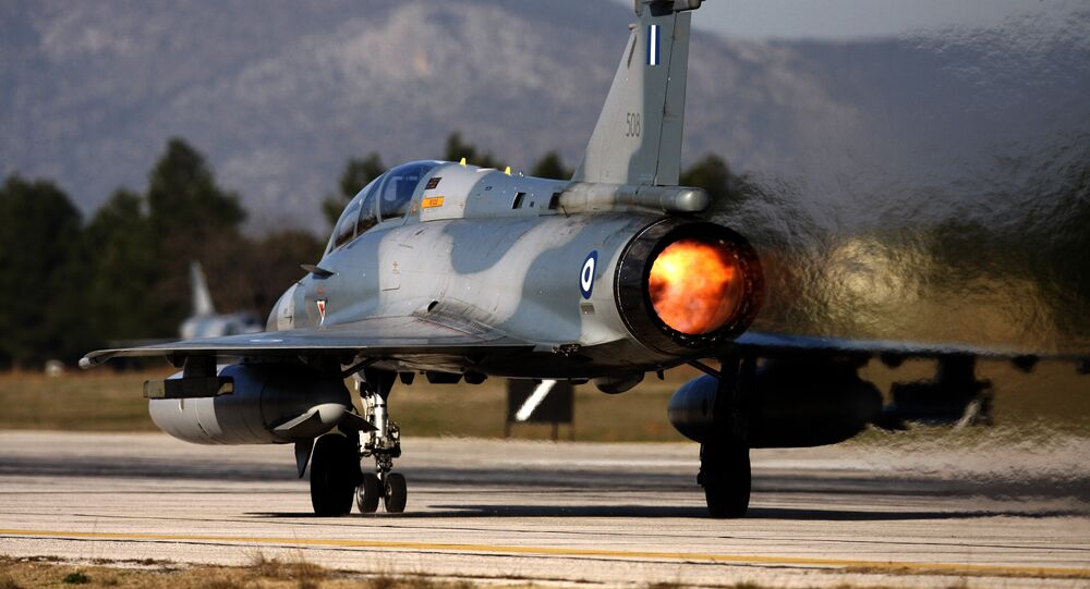 (File) An Mirage 2000-5 takes off at Tanagra Air Force base, north of Athens, Greece on Tuesday, Jan. 20, 2009