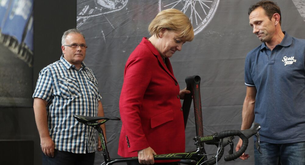 German chancellor Angela Merkel lifts a bicycle at the opening day of the Eurobike 2013, in Friedrichshafen, southern Germany. (File)