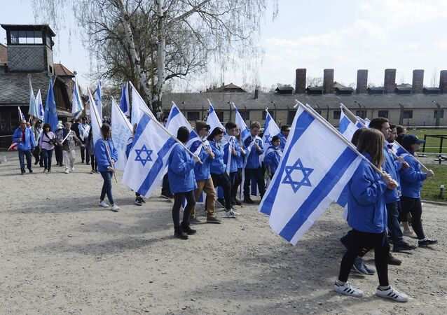 People take part in the annual March of the Living to commemorate the Holocaust, a yearly Holocaust remembrance march between the former death camps of Auschwitz and Birkenau, in Oswiecim, Poland
