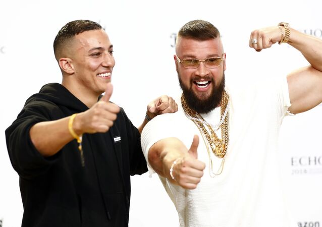 German rappers Kollegah (R) and Farid Bang pose during a photocall upon arrival for the 2018 Echo Music Award ceremony in Berlin, Germany April 12, 2018