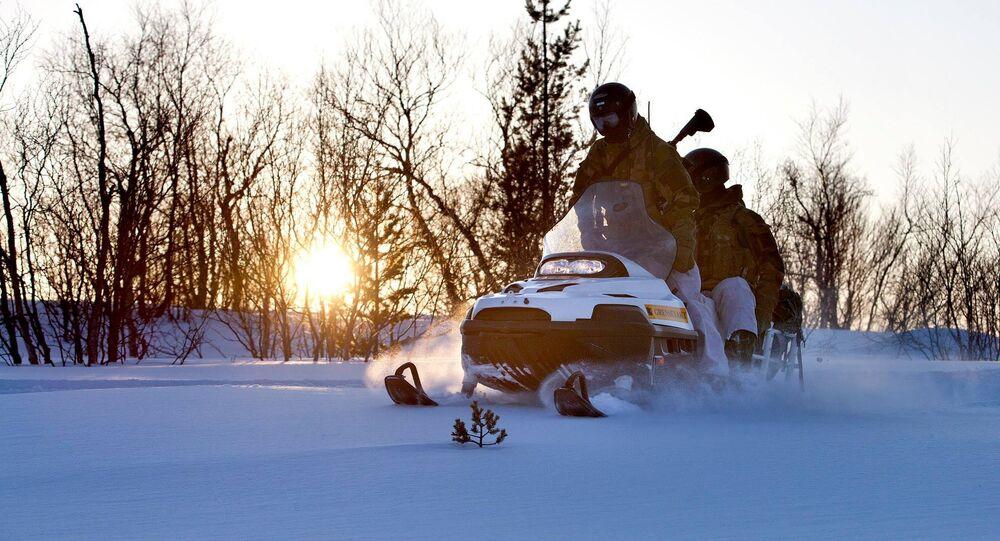 Norwegian military patrol on snow scooter