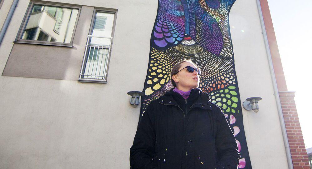 Carolina Falkholt in front of PI, on the student house Jakten, Halmstad