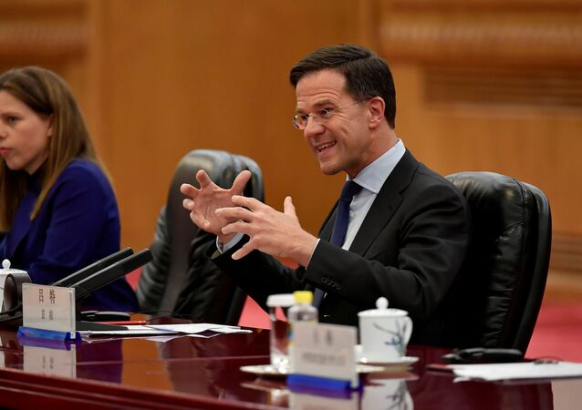 Netherlands' Prime Minister Mark Rutte (R) talks with Chinese Premier Li Keqiang (not pictured) during their meeting at the Great Hall of the People in Beijing, China April 12, 2018