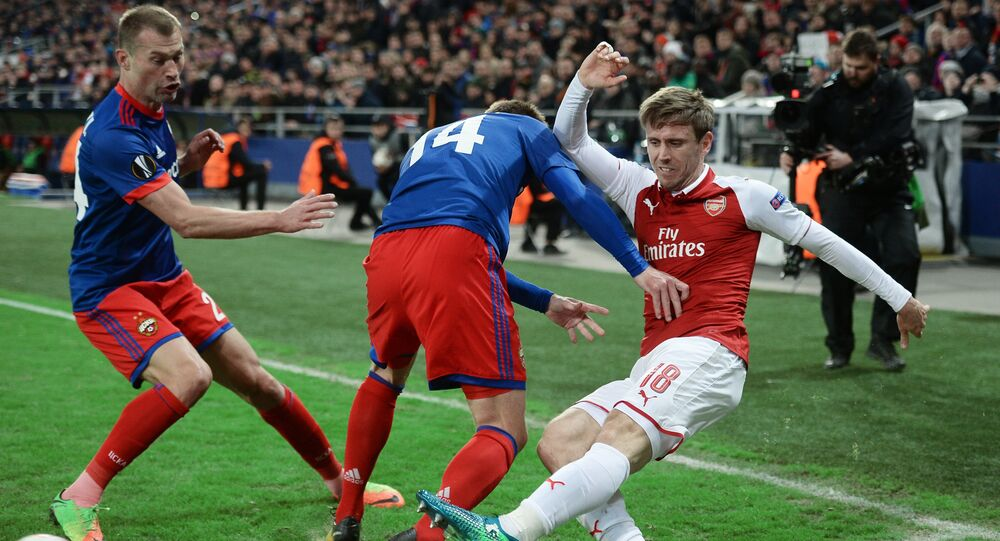 CSKA's Vasily Berezutsky, Kirill Nababkin and Arsenal's Nacho Monreal, left to right, during a quarterfinal match of the 2017/18 UEFA Europa League between CSKA (Moscow, Russia) and Arsenal (London, UK)