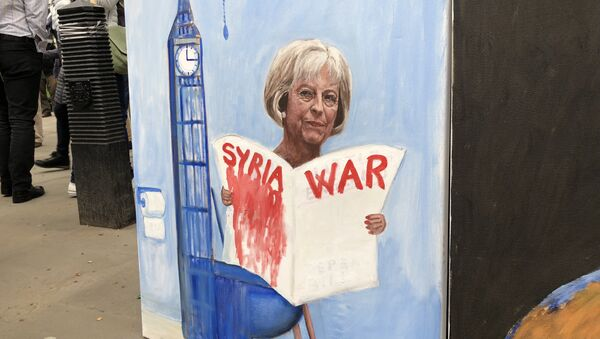 Live from Downing Street, London where crowds protest against Britain and the US launching military strikes in Syria. - Sputnik International
