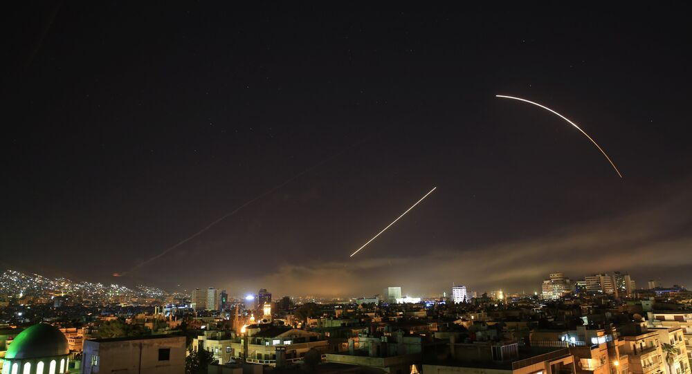 Missiles streak across the Damascus skyline as the U.S. launches an attack on Syria targeting different parts of the capital, early Saturday, April 14, 2018. Syria's capital has been rocked by loud explosions that lit up the sky with heavy smoke as U.S. President Donald Trump announced airstrikes in retaliation for the country's alleged use of chemical weapons.