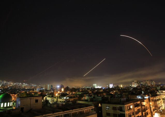 Missiles streak across the Damascus skyline amid the April 2018 US attack on Syria.