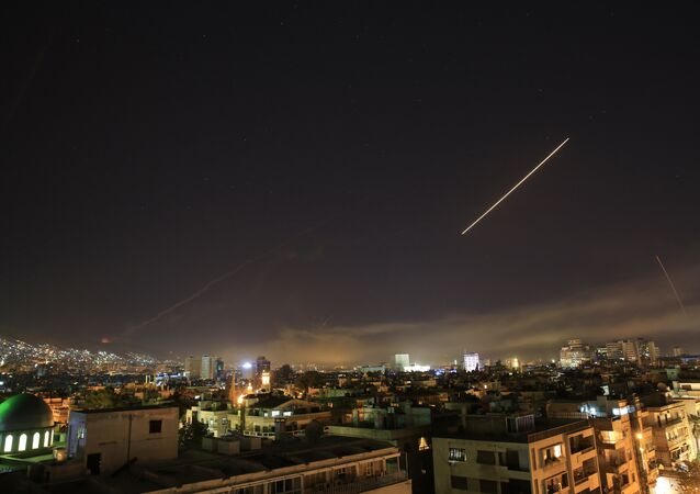 Damascus skies are alight as the U.S. launches an attack on Syria targeting different parts of the Syrian capital Damascus, Syria, early Saturday, April 14, 2018