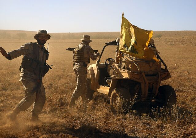 FILE - In this July 29, 2017 file photo,Hezbollah fighters stand near a four-wheel motorcycle positioned at the site where clashes erupted between Hezbollah and al-Qaida-linked fighters in Wadi al-Kheil or al-Kheil Valley in the Lebanon-Syria border