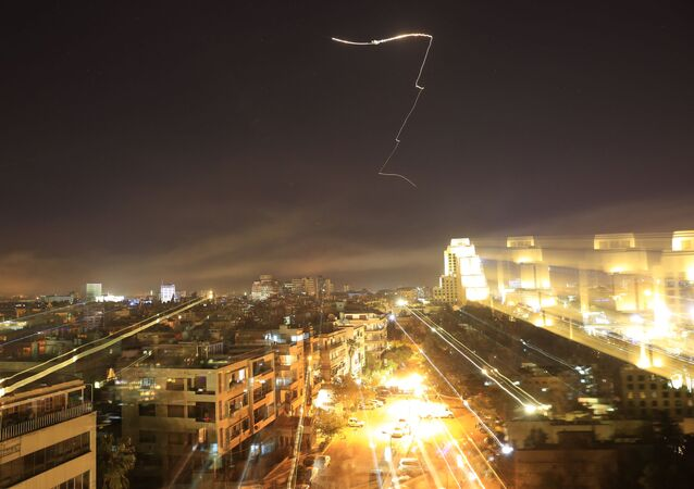 Damascus is seen as the U.S. launches an attack on Syria targeting different parts of the capital early Saturday, April 14, 2018