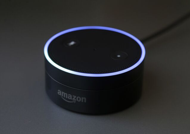 March 2, 2016 photo shows an Echo Dot in San Francisco. Amazon.com is introducing two devices, the Amazon Tap and Echo Dot, that are designed to amplify the role that its voice-controlled assistant Alexa plays in people's homes and lives
