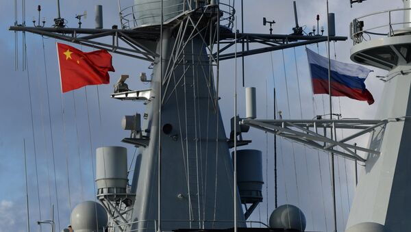 State flags of Russia and China are flown on destroyer Shijiazhuang during the Russian-Chinese exercise Naval Interaction 2017 - Sputnik International