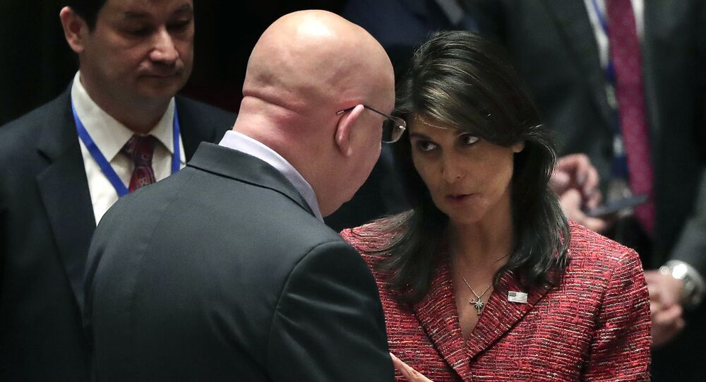United States Ambassador to the United Nations Nikki Haley, right, talks with Russian Ambassador to the United Nations Vasily Nebenzya before a Security Council meeting, Tuesday, April 10, 2018, at United Nations headquarters