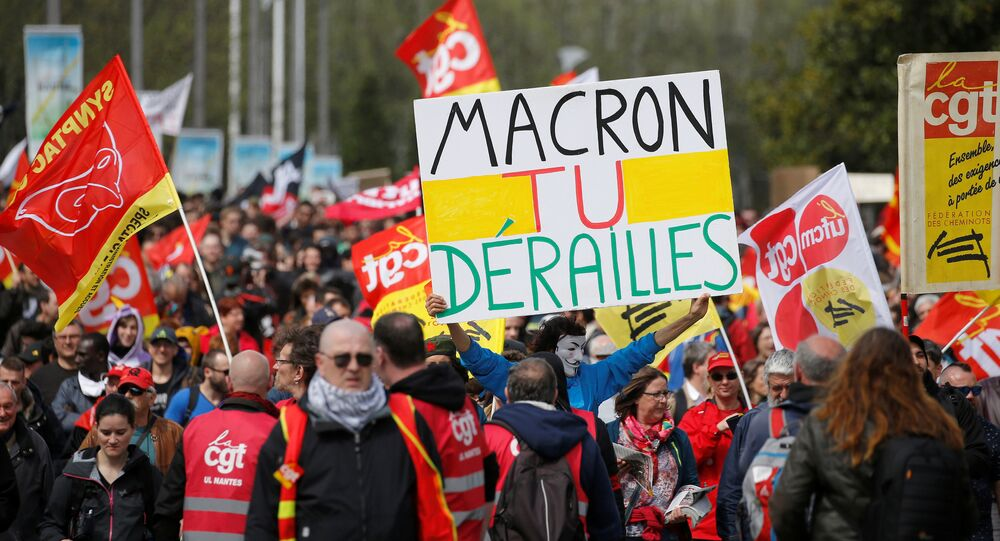 French railway employees and CGT labour union members demonstrate against government reforms in Nantes, France, April 14, 2018. Placard reads, Macron you've derailed