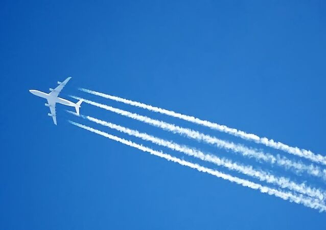 The contrails of an Airbus A340 jet, over London, England