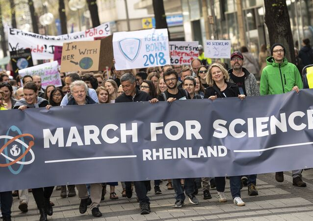 Protesters attend a 'March For Science' in Cologne, Germany, to support global freedom for science.