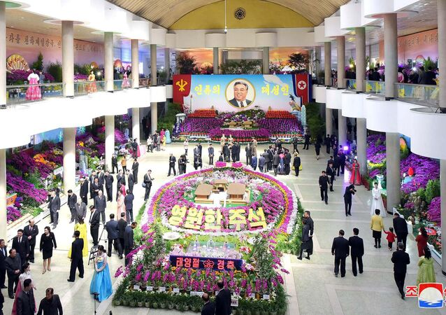 People are seen during the 20th Kimilsungia Festival on the occasion of the birth anniversary of founder Kim Il-sung in this undated photo released by North Korea's Korean Central News Agency (KCNA) in Pyongyang April 13, 2018