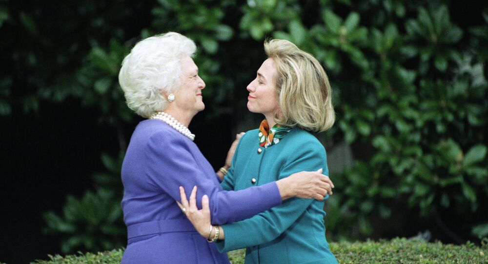 First lady Barbara Bush greets first lady-to-be Hillary Clinton upon her arrival at the White House in Washington, 1992