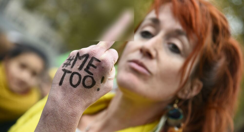 A woman with the message Me too on her hand gives the middle finger during a gathering against gender-based and sexual violence called by the Effronté-e-s Collective, on the Place de la Republique square in Paris on October 29, 2017