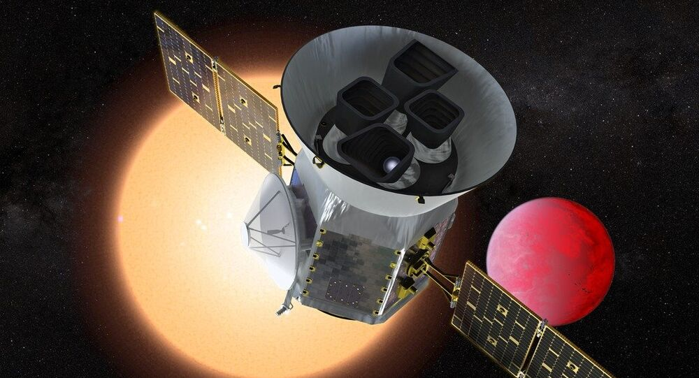 Artist concept of TESS in front of a lava planet orbiting its host star. Image credit: NASA's Goddard Space Flight Center