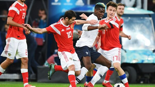 From left, first plan: Alan Dzagoyev (Russia), Paul Pogba (France) and Alexander Golovin (Russia) during the friendly match between Russia and France - Sputnik International