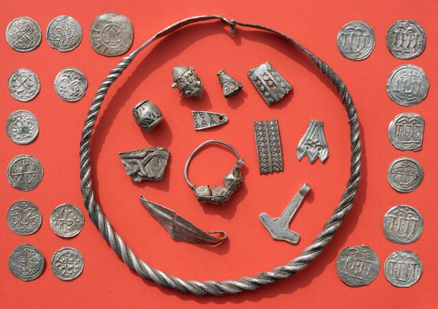 Parts of the silver treasure are pictured on a table in Schaprode, northern Germany on April 13, 2018. A 13-year-old boy and a hobby archaeologist have unearthed a significant trove in Germany which may have belonged to the legendary Danish king Harald Bluetooth who brought Christianity to Denmark