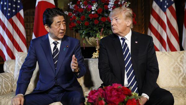 U.S. President Donald Trump listens to Japan's Prime Minister Shinzo Abe during their bilateral meeting at Trump's Mar-a-Lago estate in Palm Beach, Florida U.S., April 17, 2018 - Sputnik International