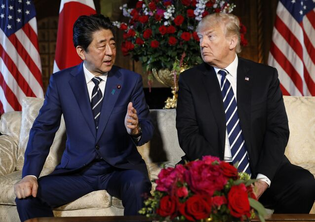 U.S. President Donald Trump listens to Japan's Prime Minister Shinzo Abe during their bilateral meeting at Trump's Mar-a-Lago estate in Palm Beach, Florida U.S., April 17, 2018