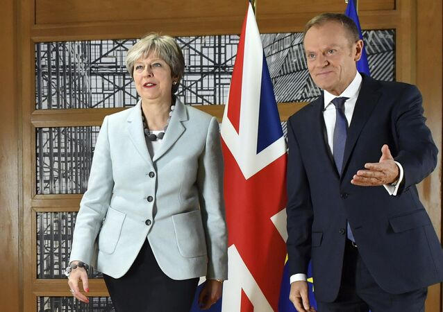 British Prime Minister Theresa May, left, walks with European Council President Donald Tusk prior to a meeting at the Europa building in Brussels on Friday, Dec. 8, 2017.