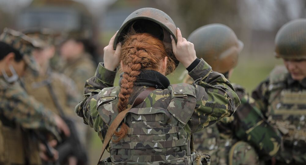 A Romanian female soldier adjusts her helmet before taking part in weapons training with US Marines female counterparts at the Capu Midia Surface to Air Firing Range, on the Black Sea coast in Romania, Monday, March 20, 2017