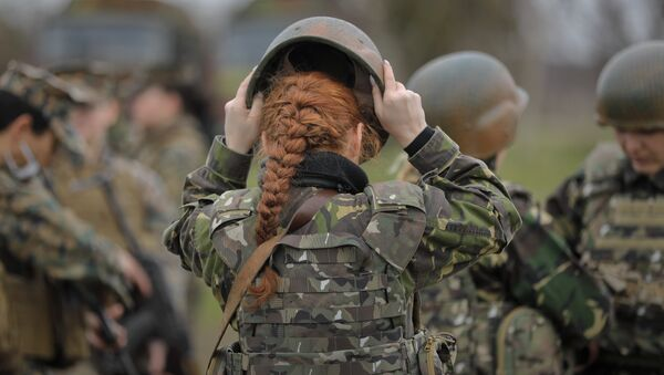 A Romanian female soldier adjusts her helmet before taking part in weapons training with US Marines female counterparts at the Capu Midia Surface to Air Firing Range, on the Black Sea coast in Romania, Monday, March 20, 2017 - Sputnik International