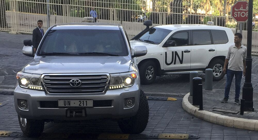 United Nations vehicles carry the team of the Organization for the Prohibition of Chemical Weapons (OPCW), arrive at hotel hours after the U.S., France and Britian launched an attack on Syrian facilities to punish President Bashar Assad for suspected chemical attack against civilians, in Damascus, Syria, Saturday, April 14, 2018