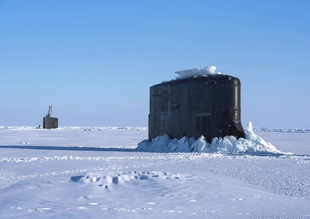 The Seawolf-class fast-attack submarine USS Connecticut and the Los Angeles-class fast-attack submarine USS Hartford break through the ice in the Beaufort Sea Saturday, March 10, 2018 in support of Ice Exercise (ICEX) 2018.