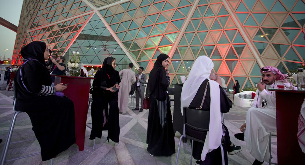 Moviegoers wait to attend an invitation-only screening, at the King Abdullah Financial District Theater, in Riyadh, Saudi Arabia, Wednesday, April 18, 2018