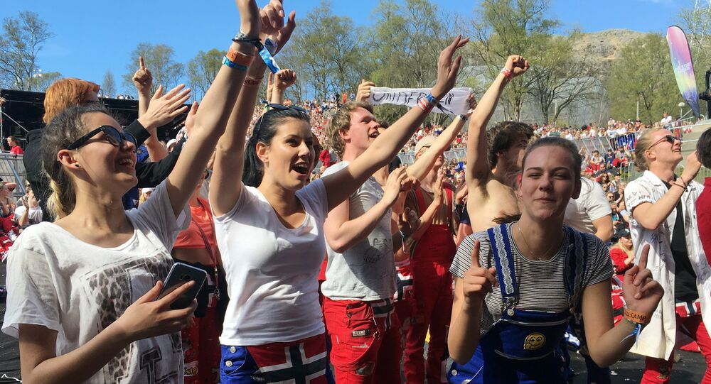 In this photo taken May 6, 2017, teenagers dance and celebrate the end of their classes, in Aalgaard, Norway